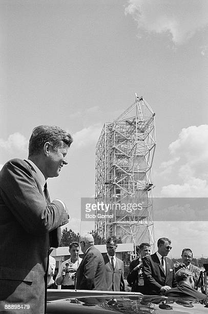 American President John F. Kennedy smiles as he reaches into his pocket during a visit to the Manned Spacecraft Center , Houston, Texas, September...