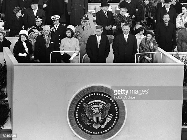 American President John Fitzgerald Kennedy stands on a platform for his inauguration as 35th President on the east front of the US Capitol, January...