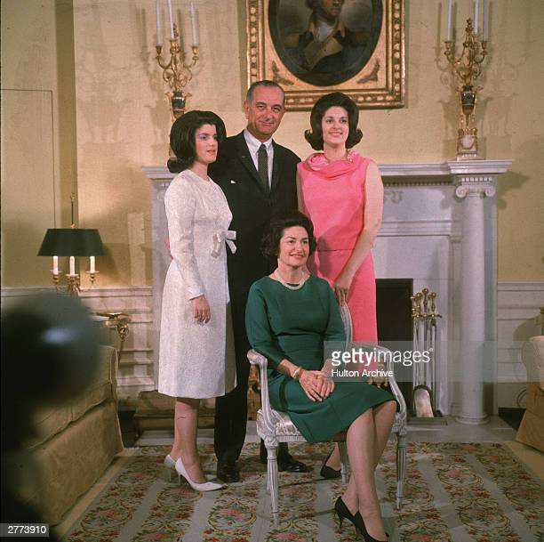 American president Lyndon Baines Johnson poses with his daughters Luci Baines Johnson Lynda Bird Johnson and his wife Lady Bird Johnson in front of a...