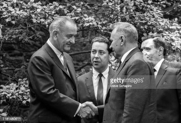 American President Lyndon Johnson and Soviet Premier Alexei Kosygin shake hands during the Glassboro Summit Conference, on the campus of Glassboro...