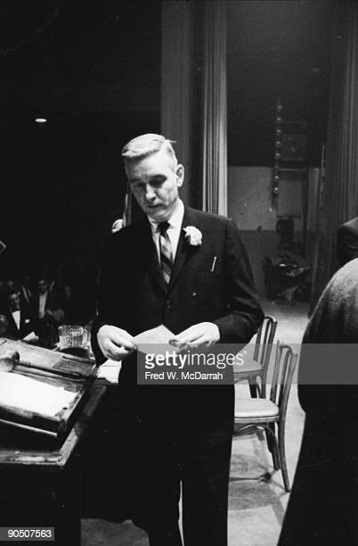 American President of the New York Typographical Union Bertram Powers reads a note on the stage at the Hotel Commodore during a negotiations to try...