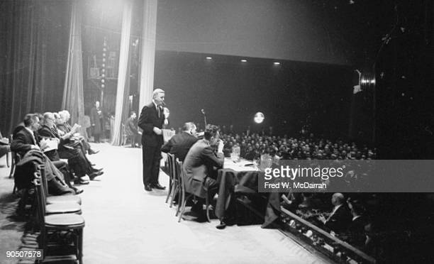 American President of the New York Typographical Union Bertram Powers smokes a cigar on the stage at the Hotel Commodore during a negotiations to try...