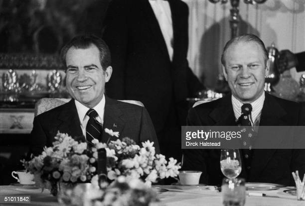 American President Richard Nixon and Vice President Gerald Ford sit next to each other at a congressional leaders breakfast at the White House...