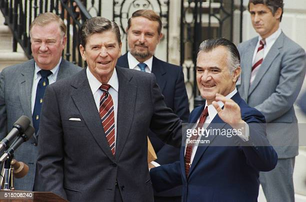 American President Ronald Reagan looks on as Mexican President Miguel de la Madrid waves during Reagan's state visit The two leaders met earlier to...