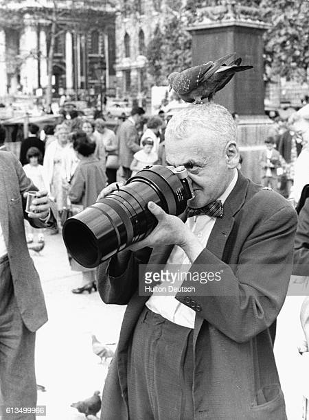 American press photographer Weegee takes pictures in Trafalgar Square London