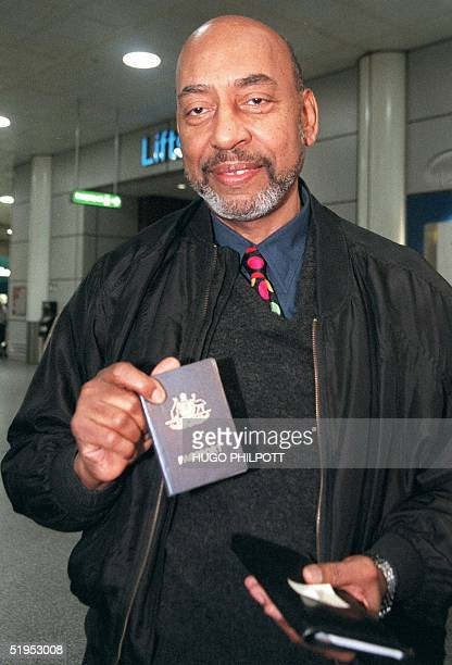 American Preston King who lived in exile for almost 40 years following an 18month jail sentence for dodging the US Army draft shows his passport at...