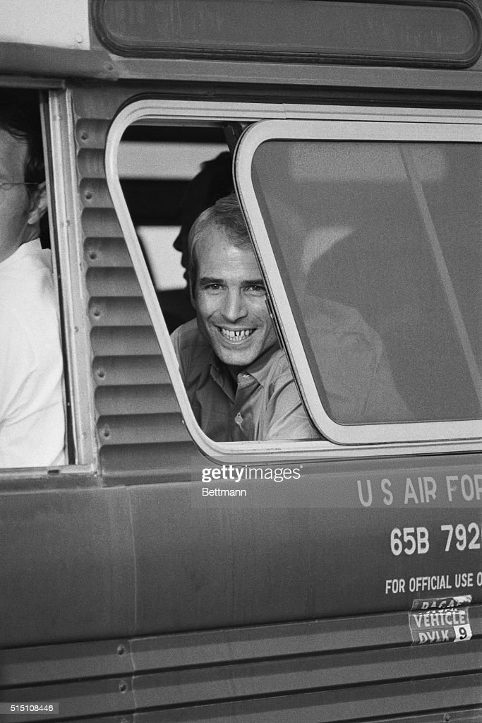 American prisoner of war, Navy Lt. Commander John McCain III, smiles from a bus window on arrival at Clark Air Base in the Philippines, after his release from Hanoi during the Vietnam War, 14th March 1973. McCain was taken prisoner on 26th October 1967. He is the son of retired Admiral John S. McCain Jr., whose last post was Commander-in-Chief of the Pacific Forces.
