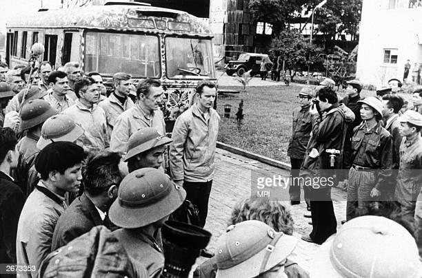 American prisoners of war reporting to US representatives at Gia Lam Airport in Hanoi