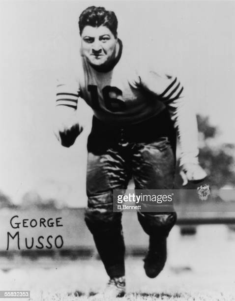 American pro football player George Musso tackle and defensive guard for the Chicago Bears from 1933 1944 runs towards the camera in this promotional...