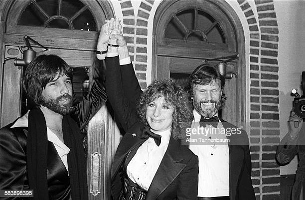American producer Jon Peters with actors Barbra Streisand and Kris Kristofferson arrive for the premiere of their film 'A Star Is Born' at Tavern on...