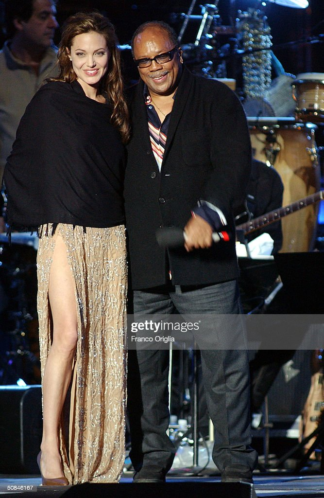 American producer Quincy Jones and actress Angelina Jolie conduct on stage at the 'We are the Future' all-star humanitarian concert May 16, 2004 at Circus Maximus in Rome, Italy. The show is being broadcast globally on MTV and will raise money to open child centers in the most war torn regions of the world.