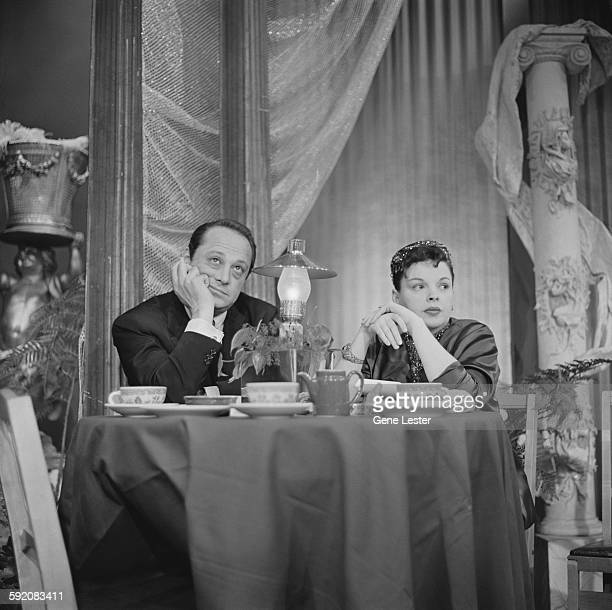 American producer Sidney Luft and actress Judy Garland sit together at the 27th Academy Award nominations event Burbank California February 12 1955