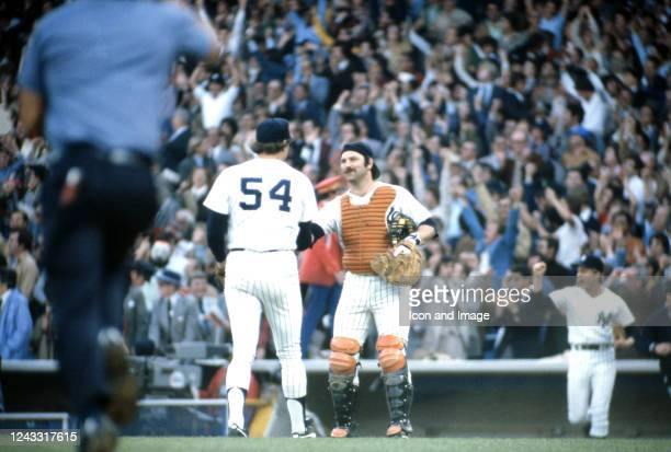 """American professional baseball catcher Thurman Munson congratulates American relief pitcher Rich """"Goose"""" Gossage after the Yankees defeated the..."""