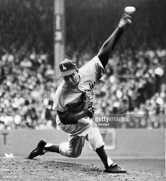 American professional baseball player and starting pitcher Johnny Podres of the Los Angeles Dodgers throws out a pitch in the fifth inning of the...