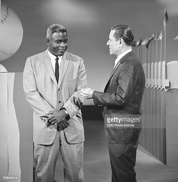 American professional baseball player Jackie Robinson who famously broke the Major League Baseball color barrier in 1947 appears on the CBS...
