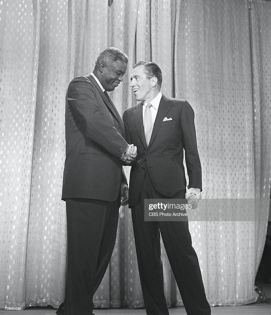 American professional baseball player Jackie Robinson (1919 - 1972) (left), who famously broke the Major League Baseball color barrier in 1947, appears on the CBS television program 'The Ed Sullivan Show' with host Ed Sullivan (1901 - 1974), New York, May 20, 1962.