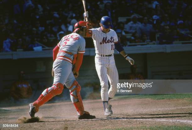 American professional baseball player Johnny Bench of the Cincinnati Reds throws back a ball missed by New York Met John Hardin Stearns during a game...