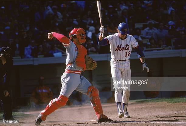 American professional baseball player Johnny Bench of the Cincinnati Reds prepares to throw back a ball missed by New York Met John Hardin Stearns...