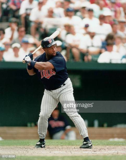 American professional baseball player Kirby Puckett of the Minnesota Twins begins to swing at a pitch during an away game late 20th Century Puckett...
