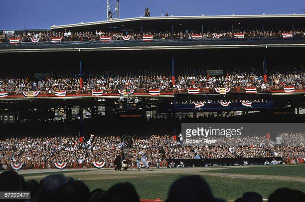 American professional baseball player Mickey Mantle of the New York Yankees swings from home plate during the 1960 World Series playing against the...