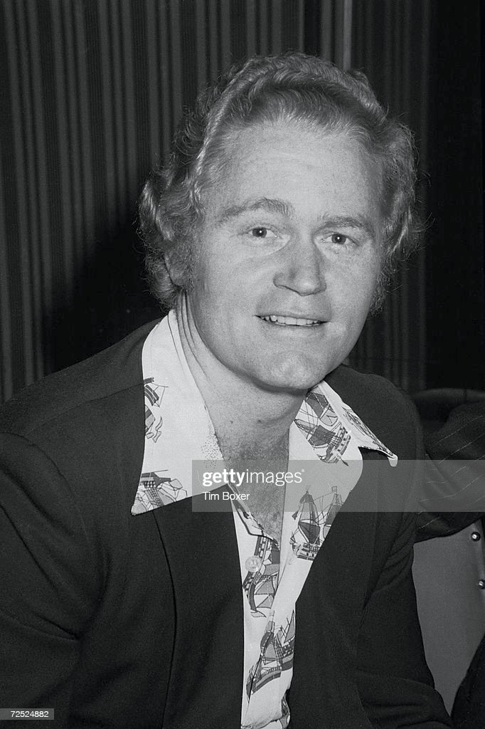 American professional baseball player Rusty Staub poses for a picture, late 1970s. Staub wears an open shirt with the collar over the lapel of his jacket. Staub played Major League baseball from 1963 to 1985.