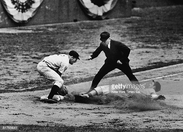 American professional baseball player Stan Musial a rookie for the St Louis Cardinals slides into third base and is called safe by the umpire during...