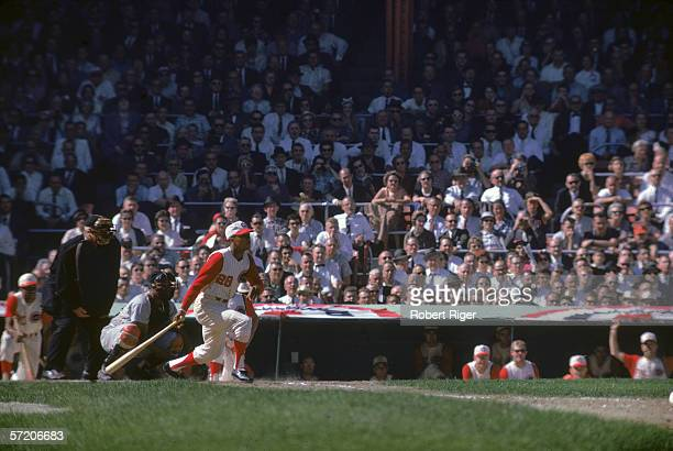 American professional baseball player Vada Pinson of the Cincinnati Reds prepares to take off for first base after making a hit at home plate during...