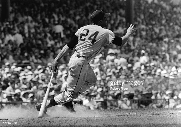 American professional baseball player Willie Mays of the New York and San Francisco Giants heads for first base after hitting the ball during a game,...