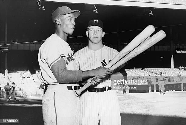 American professional baseball players and hall of fame members Ernie Banks of the Chicago Cubs and Mickey Mantle of the New York Yankees the leading...