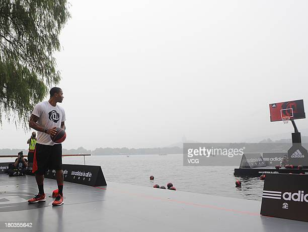 American professional basketball player Derrick Rose of the Chicago Bulls meets fans at West Lake on September 11 2013 in Hangzhou China