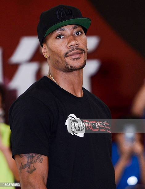 American professional basketball player Derrick Rose of the Chicago Bulls meets fans at Dongguan Basketball School on September 12 2013 in Dongguan...