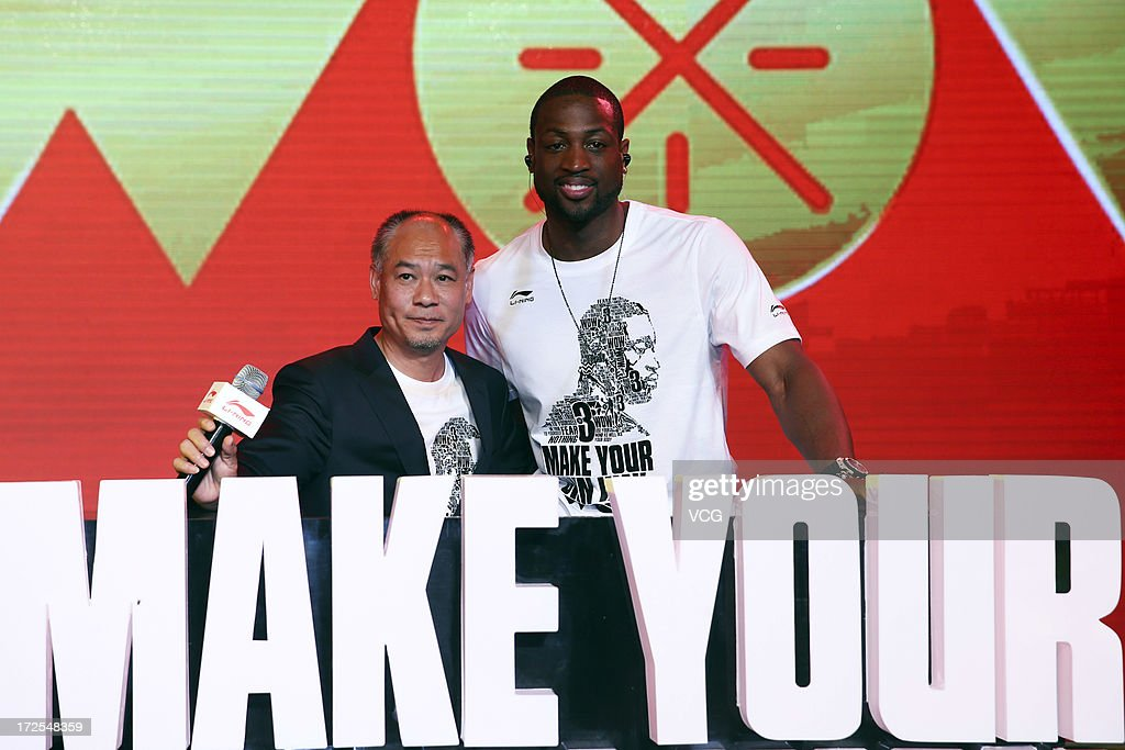 American professional basketball player Dwyane Wade (R) of the Miami Heat poses with sporting goods executive Li Ning during a meeting with fans on July 3, 2013 in Beijing, China.