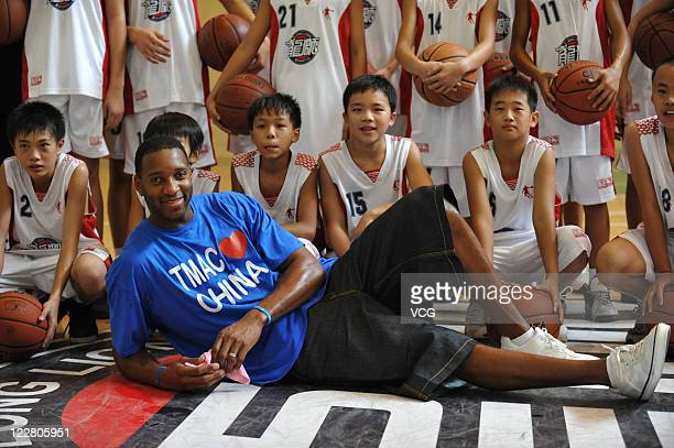 American professional basketball player Tracy McGrady of the Detroit Pistons during his meeting with fans on August 28 2011 in Foshan Guangdong...