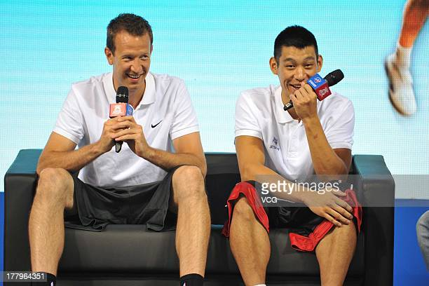 American professional basketball players Jeremy Lin of the Houston Rockets and Steve Novak of the Toronto Raptors talk to young kids at a Jeremy Lin...