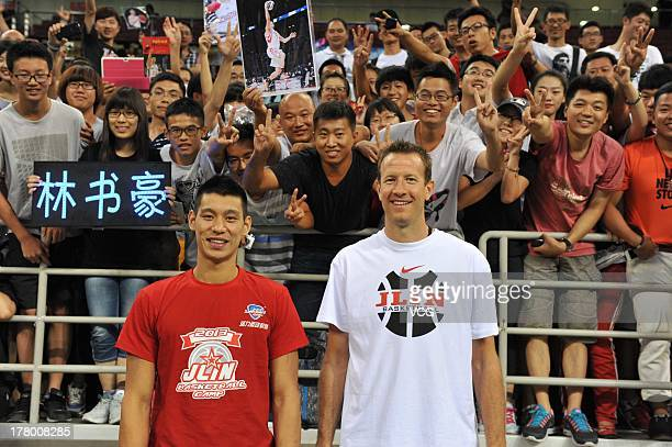 American professional basketball players Jeremy Lin of the Houston Rockets and Steve Novak of the Toronto Raptors attend a basketball training camp...