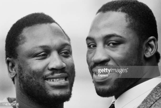 American professional boxer and trainer Joe Frazier and his son, American professional boxer Marvis Frazier, UK, 26th November 1984.