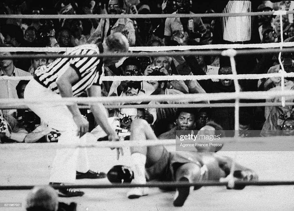 American professional boxer George Foreman, the world heavyweight champion, is down on count two after being knocked out by Muhammad Ali in the fight dubbed 'The Rumble in the Jungle,' Kinshasa, Zaire, October 30, 1974.