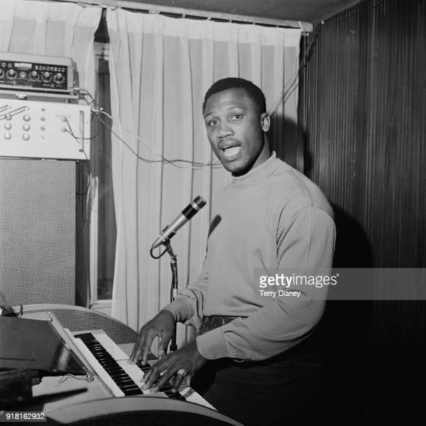 American professional boxer Joe Frazier playing a keyboard, UK, 3rd April 1968.