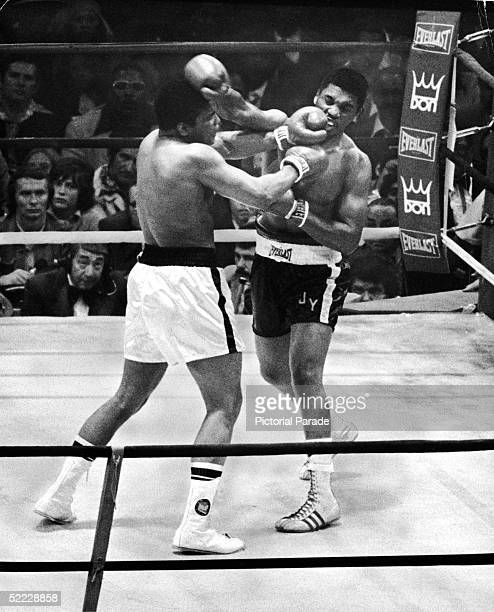 American professional boxers Muhammad Ali and Jimmy Young exchange blows during their championship bout for the world heavyweight title at the...