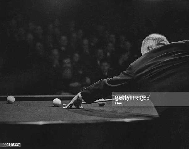 American professional carom billiards champion Willie Hoppe lines up a shot during a tournament circa 1950