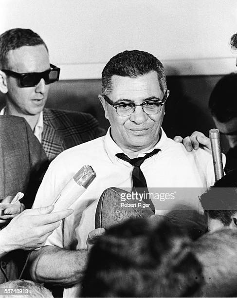 American professional football coach Vince Lombardi holds a football and participates in a press conference late 1950s Lombardi served as offensive...