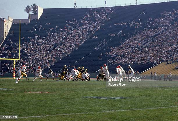 American professional football player Bart Starr quarterback for the Green Bay Packers watches a play during Super Bowl I against the Kansas City...
