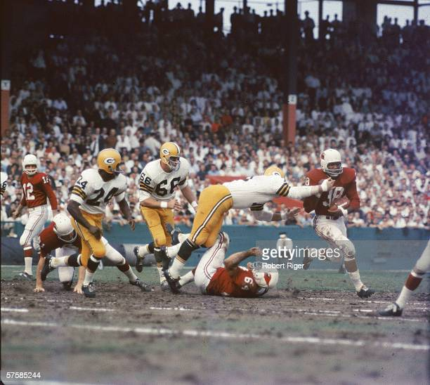 American professional football player Bill Triplett running back for the St Louis Cardinals runs the ball and attempts to escape a tackle during a...