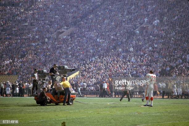 American professional football player Dave Hill of the Kansas City Chiefs is filmed by a CBS Television camera crew at Super Bowl One between the...