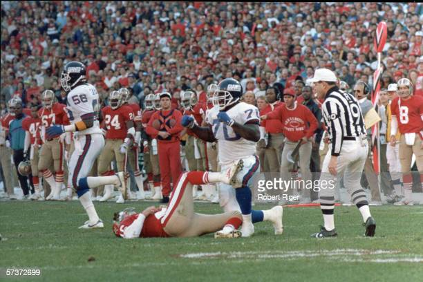 American professional football player Leonard Marshall defensive lineman for the New York Giants rejoices after hitting San Francisco 49ers...