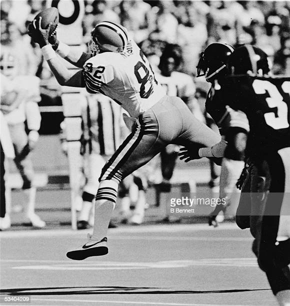 American professional football player Ozzie Newsome of the Cleveland Browns reaches to make a catch during a game early 1980s