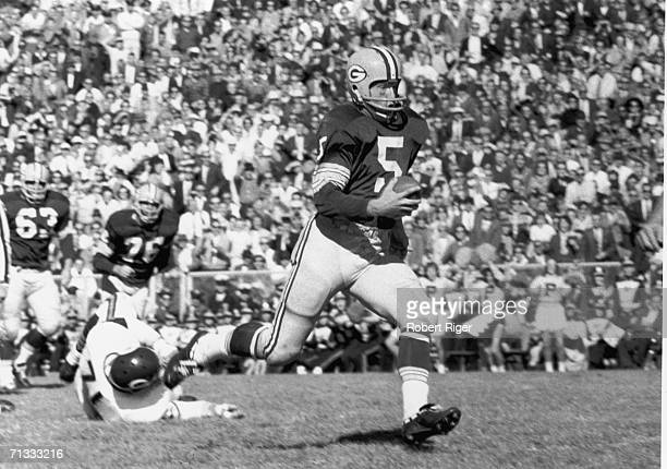 American professional football player Paul Hornung running back for the Green Bay Packers runs with the ball during a game late 1950s to mid 1960s