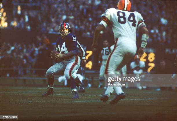American professional football player YA Tittle quarterback of the New York Giants prepares to pass the ball during a game against the Cleveland...