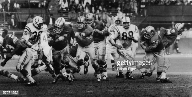 American professional football players and Detroit Lions offensive players Harley Sewell John Gordy and Dan LaRose form the interference for fullback...
