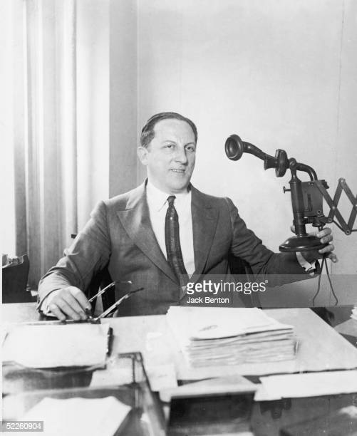 American professional gambler Arnold Rothstein sits at his desk and pulls the telephone from the wall 1910s Rothstein was accused of masterminding...